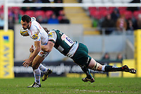 Phil Dollman of Exeter Chiefs is tackled by Tom Croft of Leicester Tigers. Aviva Premiership match, between Leicester Tigers and Exeter Chiefs on March 6, 2016 at Welford Road in Leicester, England. Photo by: Patrick Khachfe / JMP