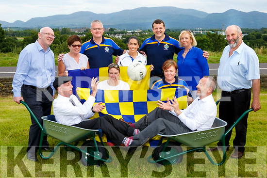 Michael Healy Rae  passes to Sean Kelly as John Brassil and Danny Healy Rae do the heavy lifting at the launch of the 40th year of Glenflesk life with back row l-r: Peggy Horan, James Furlong,  Michelle Morris, Danielle Favier, Derry Healy,Marie O'Connor, and Breda Lynch
