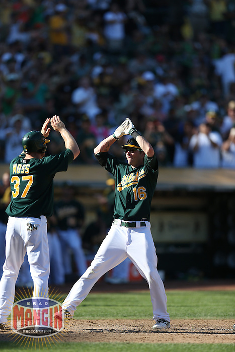 OAKLAND, CA - SEPTEMBER 30:  Josh Reddick #16 of the Oakland Athletics celebrates with teammate Brandon Moss #37 at home plate after hitting a two-run home run in the bottom of the 8th inning against the Seattle Mariners during the game at O.co Coliseum on Sunday, September 30, 2012 in Oakland, California. Photo by Brad Mangin