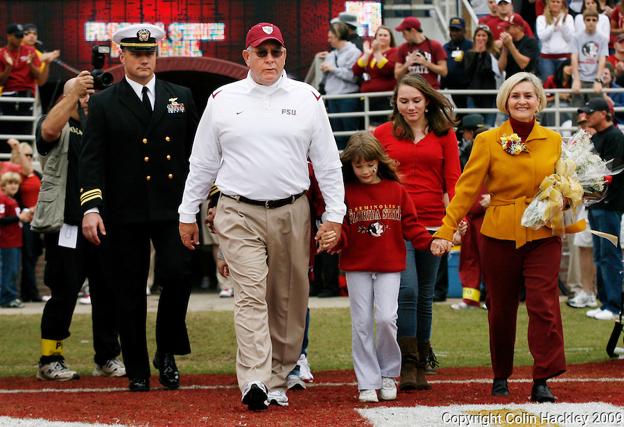 TALLAHASSEE, FL 11/21/09-FSU-MARY FB09 CH13-Florida State Defensive Coordinator Mickey Andrews, second from left, takes the field with his family for his last game at Doak Campbell Stadium, Saturday at  in Tallahassee. .COLIN HACKLEY PHOTO