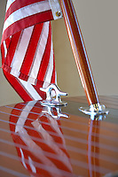 American flag and chrome fittings on Hackercraft wooden boat. Lake Tahoe. California