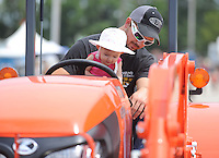 NWA Media/ANDY SHUPE - Shane Twenter of Gentry sits with his niece, June Dann, 10 months, atop a tractor on display Saturday, Aug. 30, 2014, at the Washington County Fair in Fayetteville. The fair concluded Saturday.
