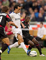 San Jose Earthquakes' Landon Donovan and D.C. United's Freddy Adu battle for the ball as Dema Kovalenko comes over to assist. DC United defeated the San Jose Earthquakes 2 to 1 during the MLS season opener at RFK Stadium, Washington, DC, on April 3, 2004.