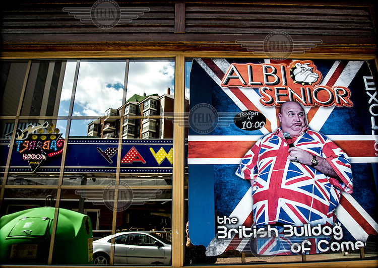 An advertisement for a performance by Albi Senior, 'the British Bulldog of Comedy', at a nightclub on Avenida de Mallorca hotspot for ex-pat entertainments in Benidorm. Spain is home to more British ex-pats than anywhere else in the world, mostly concentrated in its Mediterranean regions a huge service industry, much of it run by other ex-pats, has grown up to provide this population with British food, drink and other home comforts.