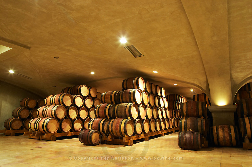 Wooden barrels with aging wine in the cellar of Guigal in Ampuis. The vaulted roof, specially reinforced to withstand the heavy weight from the vat room above.  Domaine E Guigal, Ampuis, Cote Rotie, Rhone, France, Europe