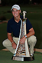 Martin KAYMER (GER) poses with the Race to Dubai Trophy after the final round of the Dubai World Championship presented by DP World, played over the Earth Course, Jumeira Golf Estates on 28th November 2010 in Dubai, UAE..........