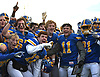 Matthew Sluka #10, Kellenberg quarterback, fourth from right (left of Jake Deakin #11) and the Firebirds celebrate after their 41-6 win over Xavier (Manhattan) in the NYCHSFL Class AA final at Mitchel Athletic Complex in Uniondale on Saturday, Nov. 17, 2018.