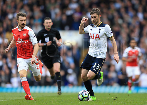 April 30th 2017, White Hart Lane, Tottenham, London England; EPL Premier League football Tottenham Hotspur versus Arsenal; Ben Davies of Tottenham Hotspur brings the ball forward with Aaron Ramsey of Arsenal attempting to catch the Spurs player