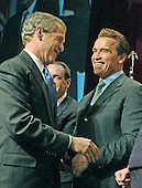 Washington, DC - February 23, 2004 -- United States President George W. Bush shakes hands with California Governor Arnold Schwarzenegger at a Republican Governors Association (RGA) meeting in Washington, D.C. on February 23, 2004..Credit: Ron Sachs / CNP