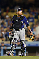 Yorvit Torrealba #8 of the Colorado Rockies during a game against the Los Angeles Dodgers at Dodger Stadium on April 30, 2013 in Los Angeles, California. (Larry Goren/Four Seam Images)