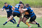 Ben Ormsby get well tackled by Kieran Whyte and Zac Wootten. Counties Manukau Premier Counties Power Club Rugby Round 2, Game of the Week, between Te Kauwhata and Onewhero, played at Te Kauwhata on Saturday March 17th 2018. <br /> Photo by Richard Spranger.<br /> <br /> Onewhero won the game 43 - 10 after leading 21 - 10 at halftime.<br /> Te Kauwhata EnviroWaste  10 - Lani Latu try,  Caleb Brown 1 conversion, Caleb Brown 1 penalty.<br /> Onewhero 43 - Jackson Orr 2, Ilaisa Koaneti 2, Vaughan Holdt, Zac Wootten, Rhain Strang tries, Vaughan Holdt 4 conversions.