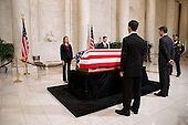 Law clerks flank the casket during a private ceremony in the Great Hall of the United States Supreme Court where late Supreme Court Justice Antonin Scalia lies in repose in Washington, DC on Friday, February 19, 2016.<br /> Credit: Jacquelyn Martin / Pool via CNP