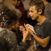 An initiation ceremony for students starting the preparatory course at  College Charlemagne, on Quai St Bernard, Paris involving competitive games and dares whilst being showered with raw eggs and flour. Collège Charlemagne is linked to, and is on the opposite of the road from Lycée Charlemagne at 13 Rue Charlemagne in the Marais district of Paris. Constructed well before it became a lycée, the building was originally the home of the Order of the Jesuits. The lycée was founded by Napoléon Bonaparte in 1804. The lycée offers two year courses (prepa), preparing students for entry to the Grandes Ecoles, focusing on mathematics, physics, chemistry and engineering. Saturday 9th September 2017. Copyright photograph by Andrew Lyndon-Skeggs. www.anlsphotography.photoshelter.com