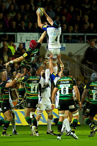 Northampton's Christian Day (5, green) contests for the ball with Bath's Stuart Hooper (4, white) during their teams' Aviva Premiership match at Franklin's Gardens on 17th September 2010.  Northampton won the match 31-10.