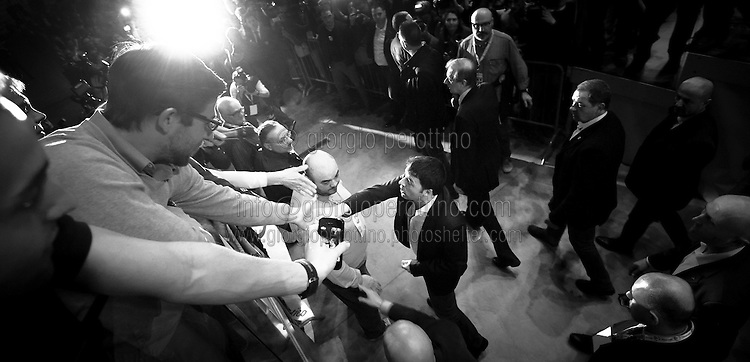 Matteo Renzi shakes hands to some supporters as he joins a political campaign convention of Partito Democratico - the Italian left-wing Party - for the Italian government elections in Turin, April 12, 2014.