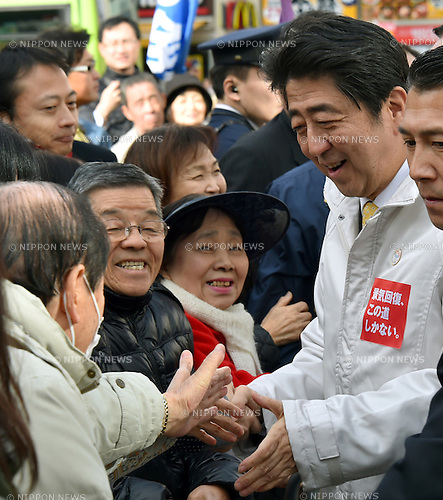 Decem ber 7, 2014, Tokyo, Japan - Japan's Prime Minister Shinzo Abe shakes hands with voters during his stumping stop in the capital's 12th precinct on Sunday, December 7, 2014. Transport Minister Akihiro Ota of Komeito, the ruling coalition ally of the Liberal Democratic Party is running from the precinct. Abe's LDP is expected to retain its dominance in the December 14 parliament's lower house election, according to latest polls. (Photo by Natsuki Sakai/AFLO) AYF -mis-
