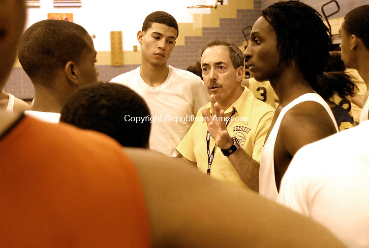 WATERBURY, CT- 14 DECEMBER 2006-121406JS01-Kennedy High School boys basketball coach Jack Taglia, talks with his players at the end  of Thursday's practice at Kennedy High School in Waterbury. <br /> Jim Shannon/Republican-American