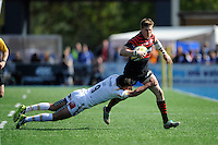 David Strettle of Saracens is tackled by Jonny Arr of Worcester Warriors during the Aviva Premiership match between Saracens and Worcester Warriors at Allianz Park on Saturday 3rd May 2014 (Photo by Rob Munro)
