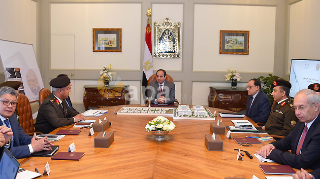 Egyptian President Abdel Fattah al-Sisi  meets with Mustafa Madbouli, Housing Minister in Cairo, Egypt , on March 6, 2017. Photo by Egyptian President Office