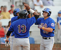 Designated hitter Patrick Farrell (35) of the Kingsport Mets celebrates hitting a three-run home run with the players he drove in the fourth inning of a game against the Johnson City Cardinals  on July 17, 2010, at Howard Johnson Field in Johnson City, Tenn. It was Farrell's first pro game since being drafted out of Regis University. Photo by: Tom Priddy/Four Seam Images