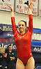 Miranda Lund of Plainview JFK turns to the judges after vaulting in the NYSPHSAA varsity gymnastics state championship meet at Cold Spring Harbor High School on Saturday, March 3, 2018.
