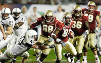 SLIPPING AWAY.  Florida State's De'Cody Fagg slips away from the grasp of Penn State defensive back Dan Connor in the second half of the 2006 FedEx Orange Bowl Game.