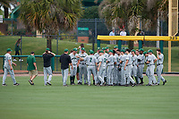 Dartmouth Big Green head coach Bob Whalen (2) addresses hist team after a game against the USF Bulls on March 17, 2019 at USF Baseball Stadium in Tampa, Florida.  USF defeated Dartmouth 4-1.  (Mike Janes/Four Seam Images)