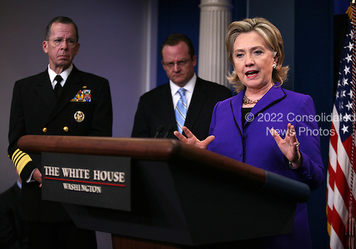 "United States Secretary of State Hillary Rodham Clinton briefs the media  on Friday, March 26, 2010 at the White House following U.S. President Barack Obama's phone call with President Dmitry Medvedev of Russia in which the two leaders agreed to sign the ""New START Treaty"" in Prague, Czech Republic on April 8, 2010. Looking on are Chairman of the Joint Chiefs of Staff Admiral Mike Mullen (left) and White House Press Secretary Robert Gibbs..Credit: Martin H. Simon - Pool via CNP"