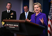 """United States Secretary of State Hillary Rodham Clinton briefs the media  on Friday, March 26, 2010 at the White House following U.S. President Barack Obama's phone call with President Dmitry Medvedev of Russia in which the two leaders agreed to sign the """"New START Treaty"""" in Prague, Czech Republic on April 8, 2010. Looking on are Chairman of the Joint Chiefs of Staff Admiral Mike Mullen (left) and White House Press Secretary Robert Gibbs..Credit: Martin H. Simon - Pool via CNP"""