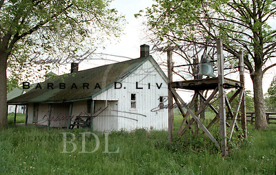 Faraway Farm - old bell (see top of stand) that was rung when an offspring of Man o' War won a stakes race.  The building has since been torn down, and the bell was moved behind the stallion barn into a place of prominence.<br /> <br /> 1998
