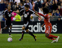 Jaime Moreno (99) of D.C. United passes the ball away from Julian de Guzman (6) of Toronto FC during the game at RFK Stadium in Washington, DC.  Toronto defeated D.C. United, 3-2.