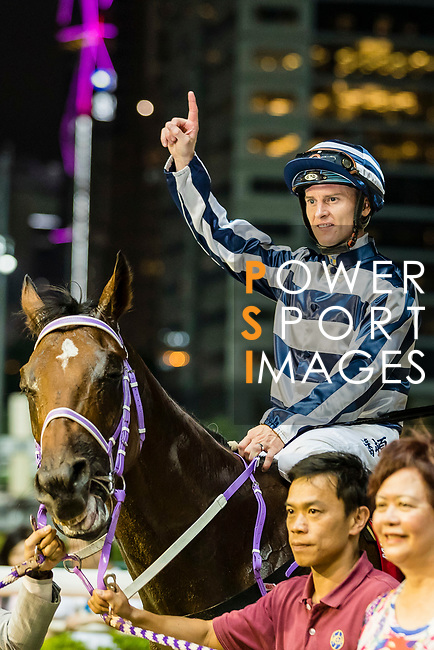 Jockey Zac Purton riding #8 Eighty Eighty celebrates after winning the race 7 during Hong Kong Racing at Happy Valley Racecourse on September 12, 2018 in Hong Kong, Hong Kong. Photo by Yu Chun Christopher Wong / Power Sport Images