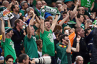 Ireland supporters in the crowd celebrate a try. Rugby World Cup Pool D match between France and Ireland on October 11, 2015 at the Millennium Stadium in Cardiff, Wales. Photo by: Patrick Khachfe / Onside Images