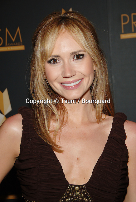 Ashley Jones  arriving at the PRISM AWARDS 2007 at the Beverly Hills Hotel in Los Angeles.<br /> <br /> headshot<br /> eye contact<br /> smile<br /> brown dress