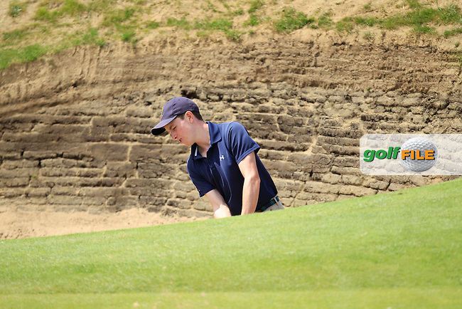 Ted Collins (Dun Laoghaire)in a bunker on the 8th green during the South of Ireland Amateur Open Championship First Round at Lahinch Golf Club  27th July 2013 <br /> Picture:  Thos Caffrey / www.golffile.ie