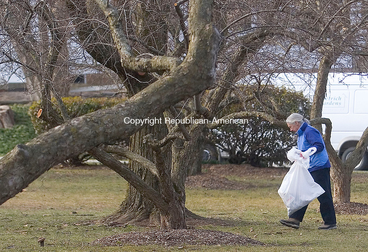 WOODBURY, CT - 07 APRIL 2007 - 040707JW07.jpg -- Priscilla Price looks for trash near the Woodbury Post office during the town of Woodburys annual spring townwide cleanup Saturday morning. Jonathan Wilcox Republican-American