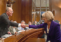 Betsy DeVos of Grand Rapids, Michigan, right, shakes hands with US Senator Lamar Alexander (Republican of Tennessee), Chairman of the US Senate Committee on Health, Education, Labor and Pensions, left, prior to the confirmation hearing considering her nomination to be US Secretary of Education on Capitol Hill in Washington, DC on Tuesday, January 17, 2017. Photo Credit: Ron Sachs/CNP/AdMedia