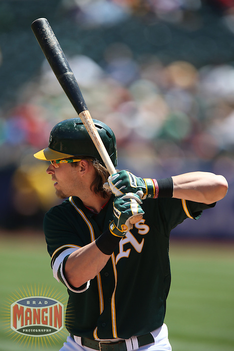 OAKLAND, CA - APRIL 30:  Josh Reddick #22 of the Oakland Athletics bats against the Los Angeles Angels during the game at O.co Coliseum on Thursday, April 30, 2015 in Oakland, California. Photo by Brad Mangin