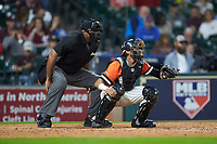 Home plate umpire Joe Harris stands behind Sam Houston State Bearkats catcher Jordan Cannon (25) in the game against the Mississippi State Bulldogs during game eight of the 2018 Shriners Hospitals for Children College Classic at Minute Maid Park on March 3, 2018 in Houston, Texas. The Bulldogs defeated the Bearkats 4-1.  (Brian Westerholt/Four Seam Images)