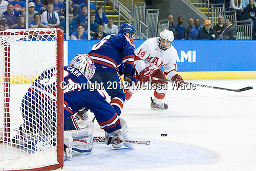 Doug Carr (UML - 31), Daniel Furlong (UML - 6), Cody Murphy (Miami - 14) - The University of Massachusetts-Lowell River Hawks defeated the Miami University Redhawks 4-3 (OT) in their NCAA East Regional semifinal on Friday, March 23, 2012, at the Webster Bank Arena in Bridgeport, Connecticut.
