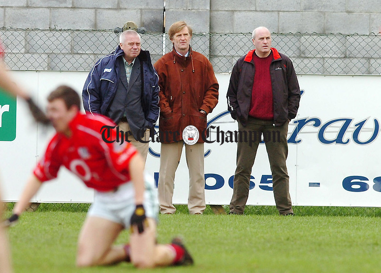 Clare Senior Football Manager Paidi O'Se with selectors Vincent O'Connor and Kieren Kelleher keep an eye on players at the U21 Challenge match between Clare and Cork at Shannon.Pic Arthur Ellis.