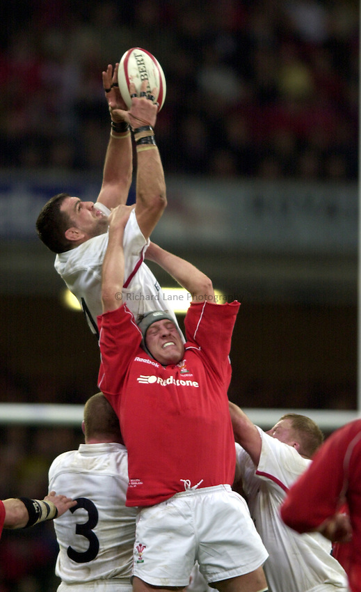 Photo Richard Lane..Wales vs England. .Lloyds T.S.B Six Nations Championship 2001..Millenium Stadium, Cardiff. 03.02.2001.Martin Johnson takes a lineout as Chris Wyatt challenges.