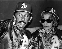 Oakland Athletics manager Billy Martin with his mother in the A's dugout before game. (1980 photo by Ron Riesterer)