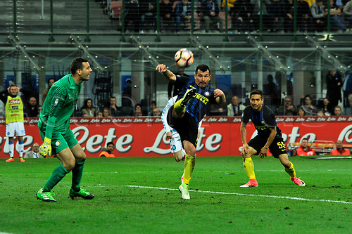 April 30th 2017, San Siro Stadium, Milan, Italy; Gary Medel of Inter  clears his box with a long kick watched by goalkeeper Handanovic during the Serie A football match, Inter Milan versus Napoli;