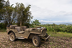 Munda, Western Province, Solomon Islands; a 1942 Jeep Willy is parked on a bluff overlooking the ocean on one of the original jungle roads used by US troops during World War II, it is the only known restored and functioning Jeep from that era in the Solomon Islands