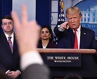 United States President Donald J. Trump takes questions on the COVID-19 (Coronavirus) pandemic alongside members of the Coronavirus Task Force in the Brady Press Briefing Room at the White House in Washington, DC on Wednesday, March 18, 2020.  Also pictured are US Secretary of Veterans Affairs (VA) Robert Wilkie, left, and Seema Verma, Administrator, Centers for Medicare and Medicaid Services, center.<br /> Credit: Kevin Dietsch / Pool via CNP/AdMedia