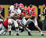 Alabama Crimson Tide running back Josh Jacobs (8) is brought down by the Georgia Bulldogs defense after a reception in the second half of the NCAA College Football Playoff National Championship at Mercedes-Benz Stadium on January 8, 2018 in Atlanta. Alabama defeated Georgia 26-23 in overtime.  Photo by Mark Wallheiser/UPI