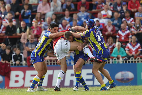 July 1st 2017, Beaumont Legal Stadium, Wakefield, England; The Betfred Super Leauge; Wakefield Trinity versus Warrington Wolves; Anthony England of Wakefield Trinity is stopped by the Warrington defence
