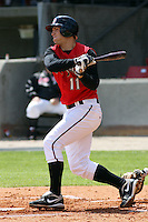 Chris Heisey of the Carolina Mudcats hitting against  the Huntsville Stars on April 22, 2009 at Five County Stadium in Zebulon, NC.