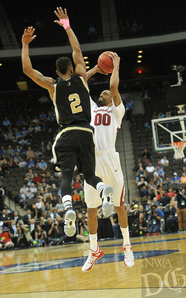 NWA Democrat-Gazette/Michael Woods --03/19/2015--w@NWAMICHAELW... University of Arkansas guard Rashad Madden pulls up for a jump shot over Wofford defender Karl Cochran in the second half of Thursday nights 56-53 win against the Wofford Terriers in the 2015 NCAA basketball tournament at Jacksonville Veterans Memorial Arena in Jacksonville, Florida.